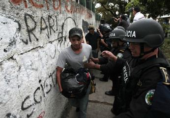 Riot police evict supporters of ousted Honduran President Manuel Zelaya from an office building in Tegucigalpa