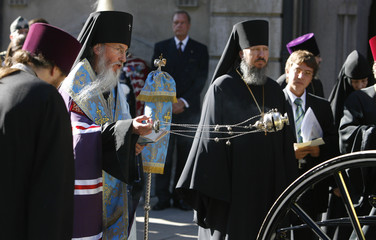Russian Orthodox priest blesses remains of Empress Fyodorovna outside Alexander Nevsky Church in Copenhagen