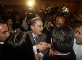 Colombian President Uribe arrives at a meeting in Mexico City