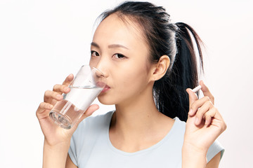 a woman drinks water from a glass