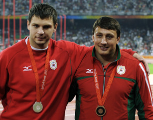 Men's hammer throw silver and bronze medallists Devyatovskiy of Belarus and compatriot Tsikhan pose after the medals ceremony at the National Stadium in the Beijing 2008 Olympic Games