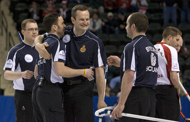 Scotland celebrates win over Canada during a playoff at the World Men's Curling Championships in Grand Forks