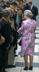 A SMALL IMMIGRANT BOY LOOKS AT QUEEN ELIZABETH IN MELBOURNE.