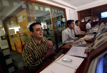 A stock broker reacts as he watches the screen at a brokerage firm in Mumbai