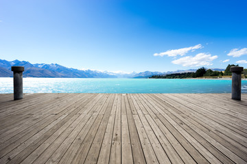 wooden floor with blue sea in blue sky