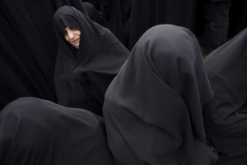 Iranian women cry while attending religious gathering to mark anniversary of death of Prophet Mohammad in Tehran