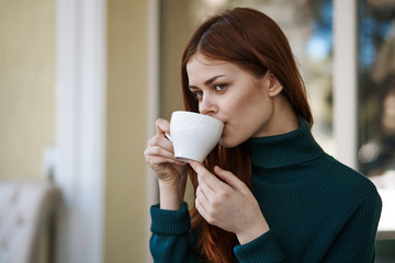 woman drinks hot drink