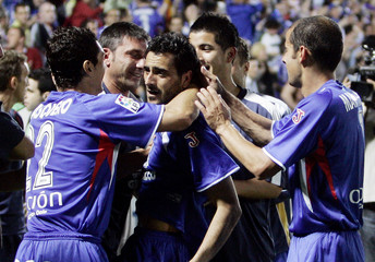 Getafe's Guiza celebrates his second goal against Barcelona with teammates during their King's Cup semi-final in Getafe