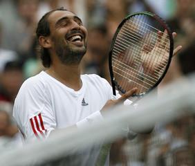 Baghdatis of Cyprus celebrates winning his quarter-final match against Australia's Hewitt at the Wimbledon tennis championships