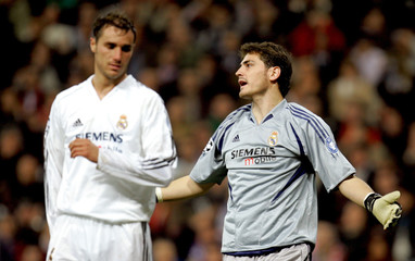 Real Madrid's goalkeeper Casillas and defender Helguera react during their Champions League soccer ...