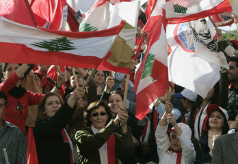 Supporters wave the national flags during a rally in support of Prime Minister Fouad Siniora in Der el-Amar, Mont Lebanon