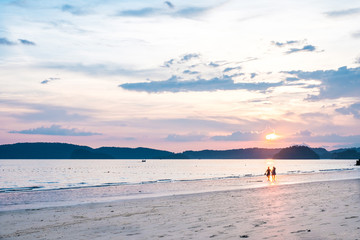 Two Lovers on the beach with Sunset at Krabi, Thailand