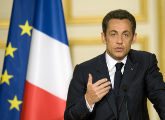 France's President Sarkozy delivers a speech in Paris
