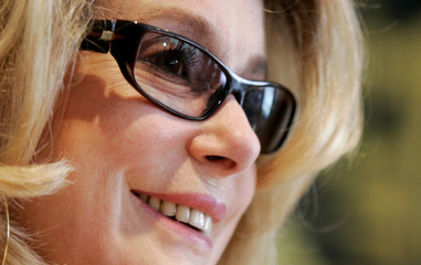 French actress Deneuve speaks to media during news conference in Lisbon