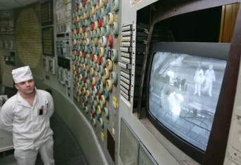 An engineer watches how nuclear fuel is unloaded from the reactor at the Chernobyl nuclear power station