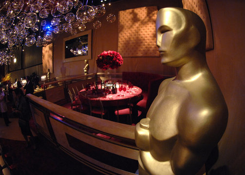 Oscar statue with table setting in background is displayed during preview of food and decor for 80th Academy Awards Governors Ball in Hollywood