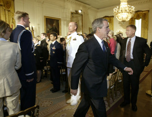 U.S. PRESIDENT BUSH LEAVES A CEREMONY WELCOMING NEW MILLENNIUM CHALLENGE COUNTRIES AT THE WHITE HOUSE.