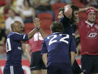 Stormers Ricky Januarie is congratulated after scoring a try during the Super 14 game against the Reds in Brisbane