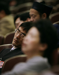 Delegates of the Chinese People's Political Consultative Conference (CPPCC) sleep during the third plenary session of NPC in Beijing
