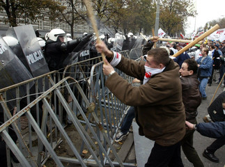 Demonstrators fight with police during a demonstration outside the Prime Minister's offices in Warsa..