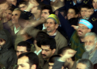 IRANIANS SHOUT ANTI-WEST SLOGANS DURING A PRAYER IN TEHRAN.