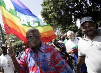 Kaunda, former president of Zambia, holds flag during opening of 2007 World Social Forum at Kibera slums in Nairobi