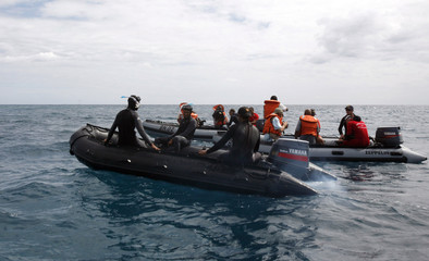 Divers patrol Indian Ocean waters during search mission for missing Yemenia Airbus A310-300 plane that crashed in Mitsamiouli