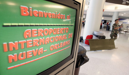 A monitor welcoming visitors is displayed in the Louis Armstrong New Orleans International Airport.