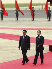 Russian President Medvedev walks with his Chinese counterpart Hu before start of official welcoming ceremony in Beijing