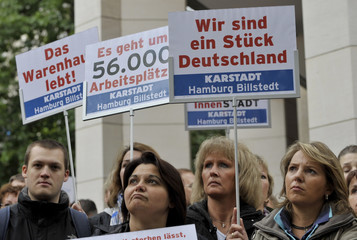 Demonstrators hold banners during a protest against Arcandor's policy on department store chain Karstadt in Hamburg