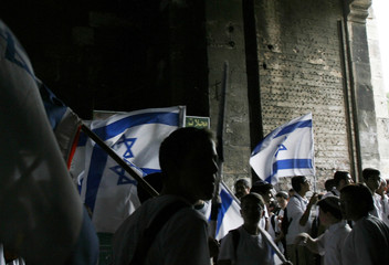 Israelis wave national flags in the Damascus Gate in the Old City of Jerusalem