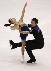 CHINESE FIGURE SKATERS ZHAO AND SHEN PERFORM PAIRS SHORT PROGRAMROUTINE.