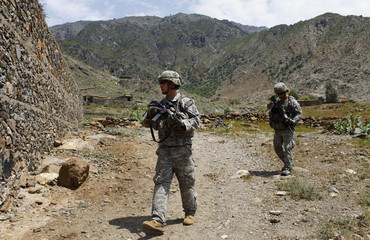 U.S. soldiers of 2-12 Infantry 4BCT-4ID Task Force Mountain Warrior walk during a patrol at the Pesh valley of Kunar Province