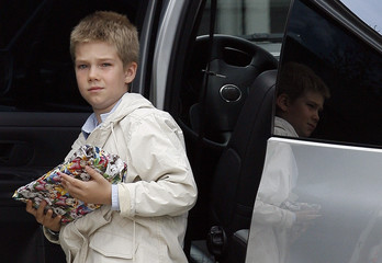 "Juan, son of Princess Cristina, arrives holding a present at Madrid's private ""Ruber Internacional"" hospital"