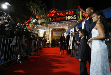 Will Smith poses with his wife Jada Pinkett and their son at the world premiere of The Pursuit of Happyness in Westwood