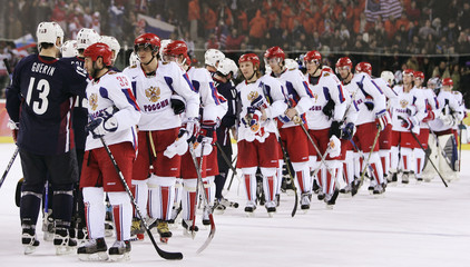 U.S. (L) and Russian players shake hands following Russia's victory at the Torino 2006 Winter Olympic Games