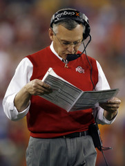 Ohio State Buckeyes coach Tressel checks playbook in first quarter of BCS National Championship college football game in Glendale