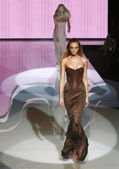 A model displays an outfit as part of Versace's Spring/Summer 2007 women's collections during Milan Fashion Week