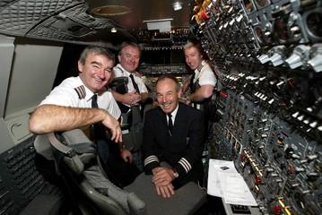 THE FLIGHT CREW OF THE LAST BRITISH AIRWAYS PASSENGER CONCORDE FLIGHTPOSE BEFORE TAKE OFF FROM JFK AIRPORT.
