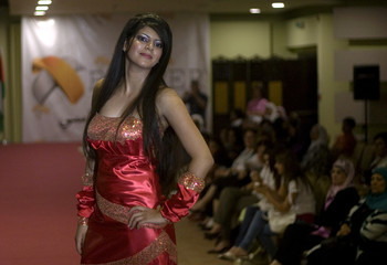 Palestinian model presents creation during fashion show in Ramallah