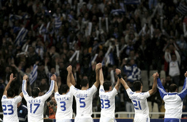 Greece's players celebrates after Euro 2008 qualifying match against Malta in Athens