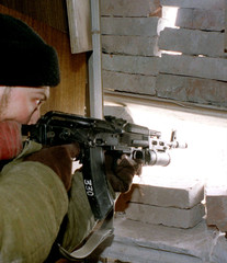 RUSSIAN SOLDIER TAKES AIM IN GROZNY.