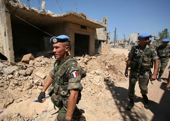 French U.N. soldiers patrol a street in Saddikeen village in south Lebanon