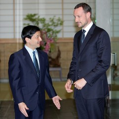 Norway's Crown Prince Haakon chats with Japanese Crown Prince Naruhito in Tokyo.
