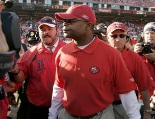 San Francisco 49ers coach Mike Singletary walks off field after loss against Seattle Seahawks in San Francisco