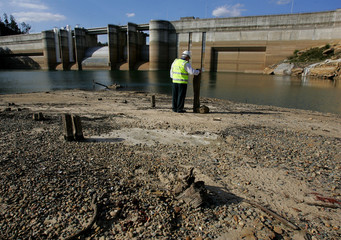 Dick Pearson from the Sydney Catchment Authority stands in front of Sydney's Warragamba Dam to ...