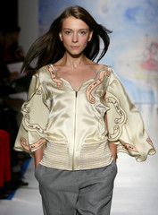 A model presents creation by Japanese designer Chisato during presentation of her Spring/Summer 2006 ready-to-wear fashion collection in Paris