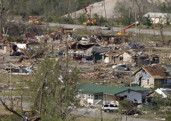 Houses damaged and destroyed by a tornado over the weekend are seen in Picher, Oklahoma