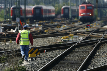 A workers walks on the tracks outside the main station in Frankfurt