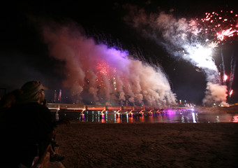 Israelis watch fireworks during the closing event of the city's centennial celebrations in Tel Aviv